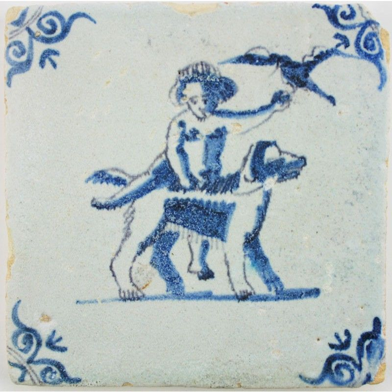 Boy, bird and dog on this Delft tile