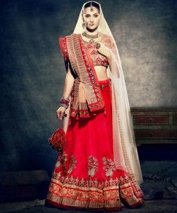 Look like a Princess with this stunning Red Bridal Velvet Lehenga, with Heavy Golden work and beautiful border and features a double dupatta look. The blouse looks killer with contrasting Beige colour and beautiful heavy work. The Crown of this outfit, the dupatta is is made of Net fabric and is beautifully done with Golden Resham and Zari.