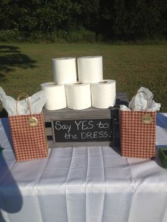Game for Couples Bridal Shower. Two teams - boys against girls - who makes the best wedding dress out of toilet paper