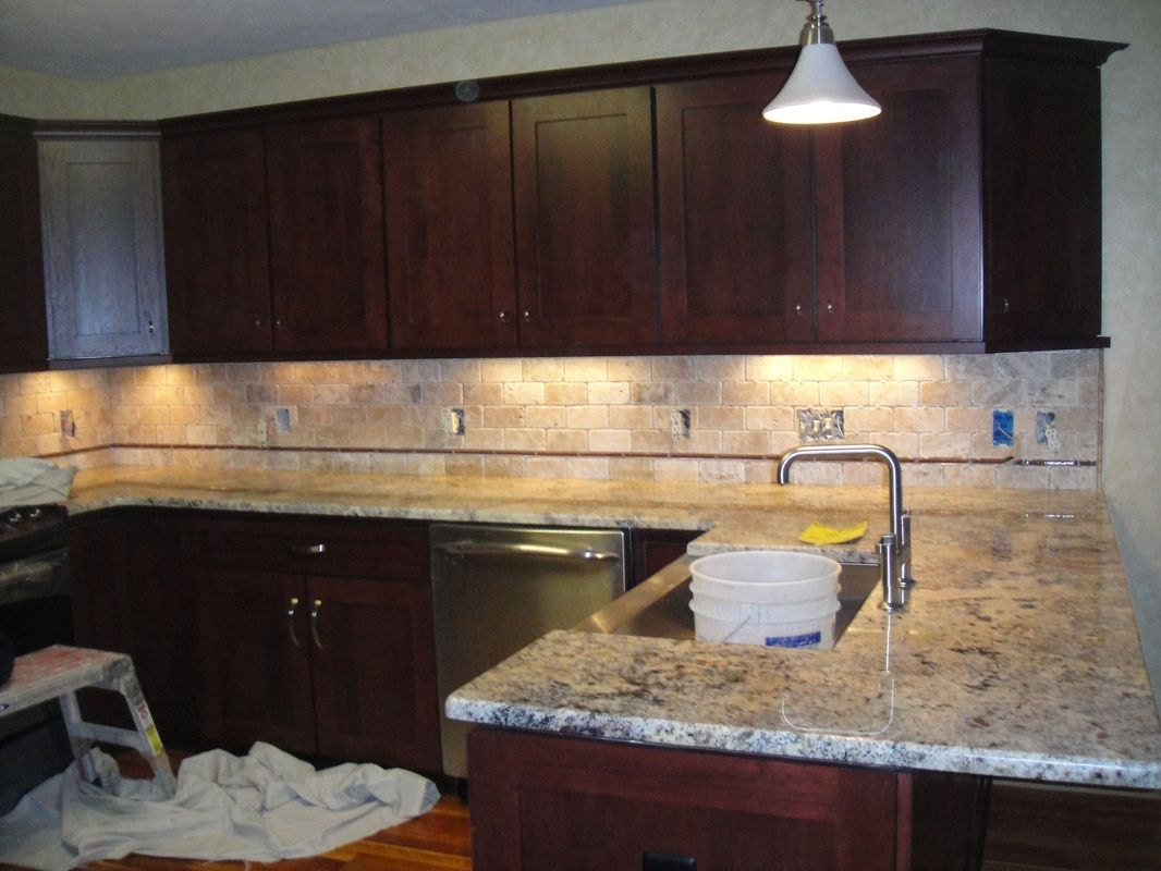 Simple kitchen ideas with brown mosaic tumbled limestone tile