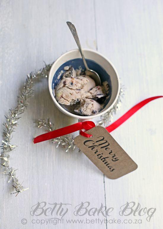 christmas ice cream with festive spices (vanilla ice cream, currants or raisins, cinnamon, fresh cherries, chocolate, 5 spice blend, almonds and pecan nuts, honey, orange rind)