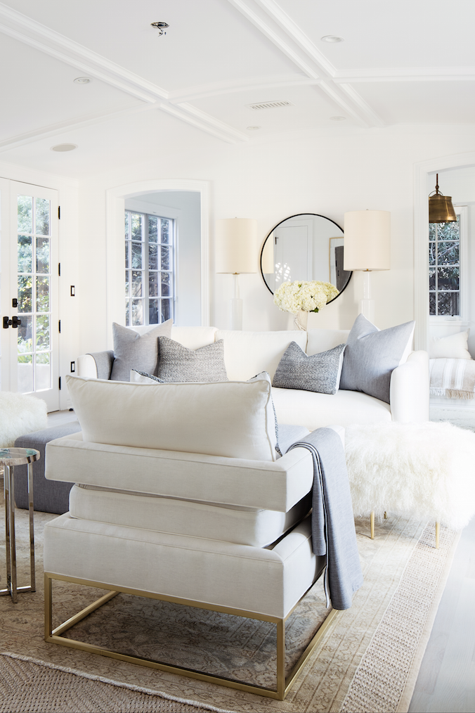 Light and bright allwhite living room with touches of
