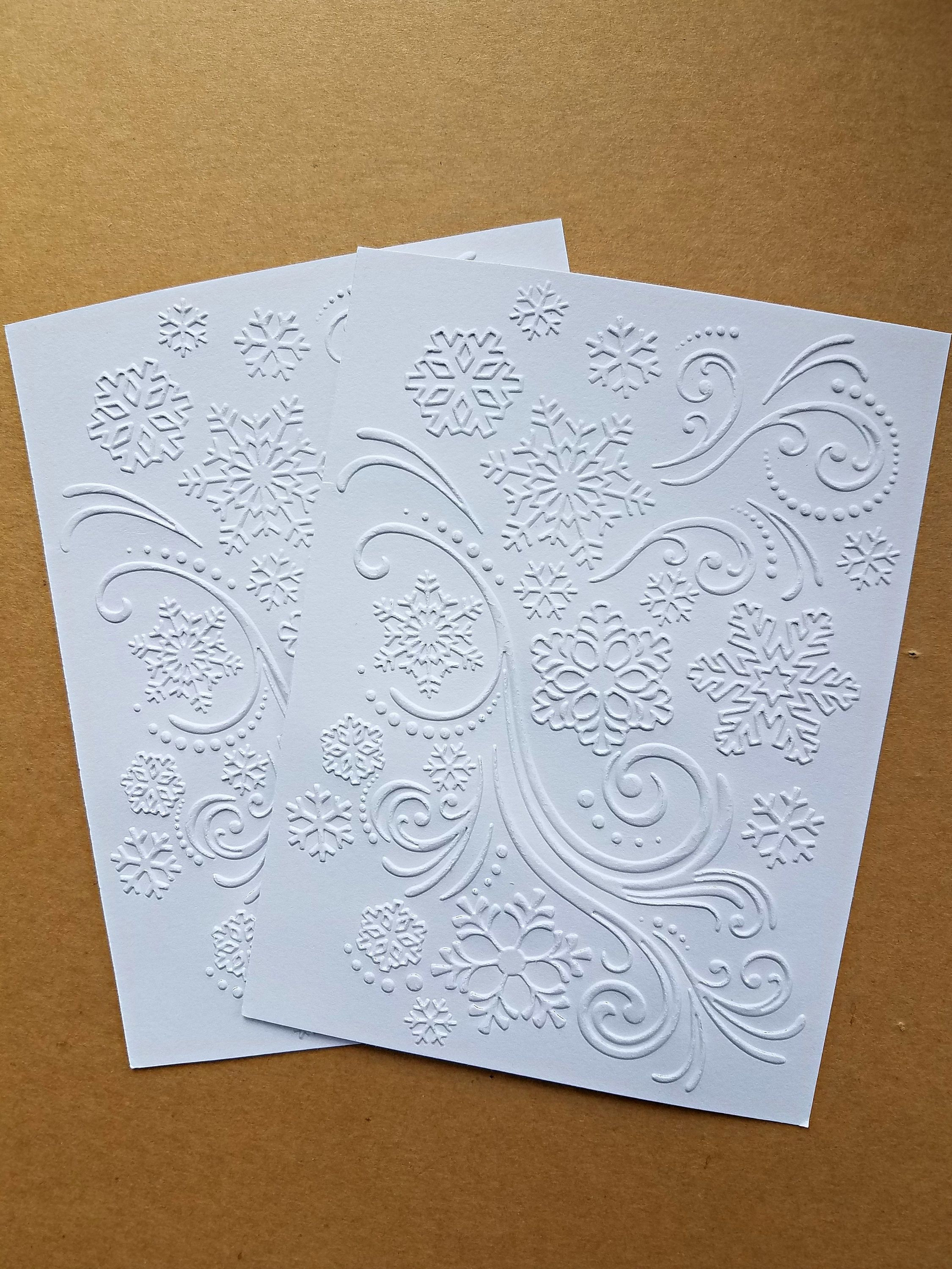 12 sheets embossed card stock snowflake swirls by