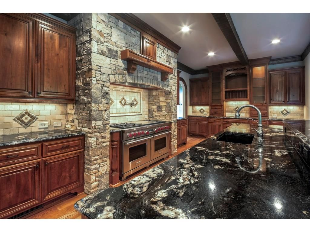 Loving Every Aspect Of This Kitchen Custom Cabinets Dark Granite Counter Tops Exquisite Stonework Kitchens Custom Kitchen Cabinets Custom Cabinets Kitchen