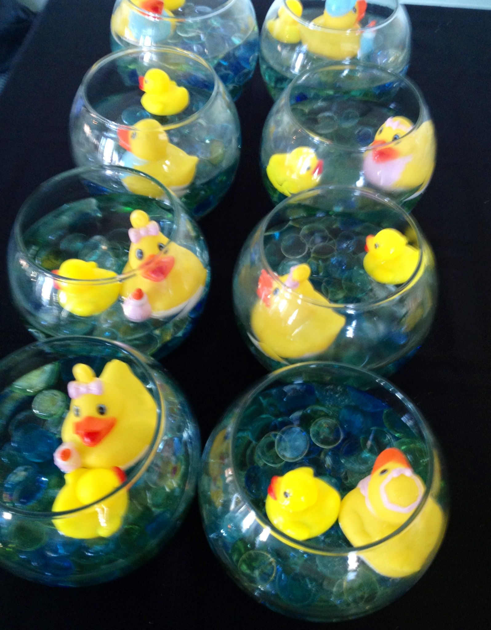 Table Decor! Mancala Beads, Water, And Rubber Ducks In A Glass Bowl