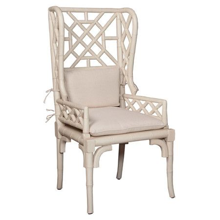 A hand-carved openwork back gives this mahogany wood arm chair a breezy feel, while its wingback silhouette evokes timeless designs. Pull it up to your dinin...