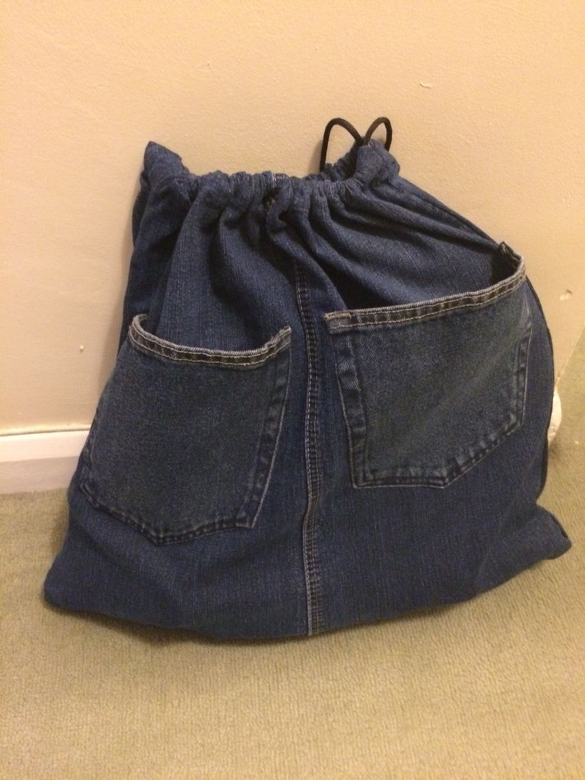 Drawstring bag with pockets made from old denim jeans