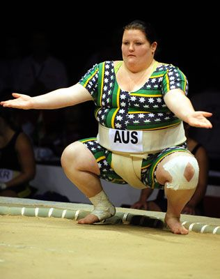 Female sumo wrestlers step into the ring and fight for