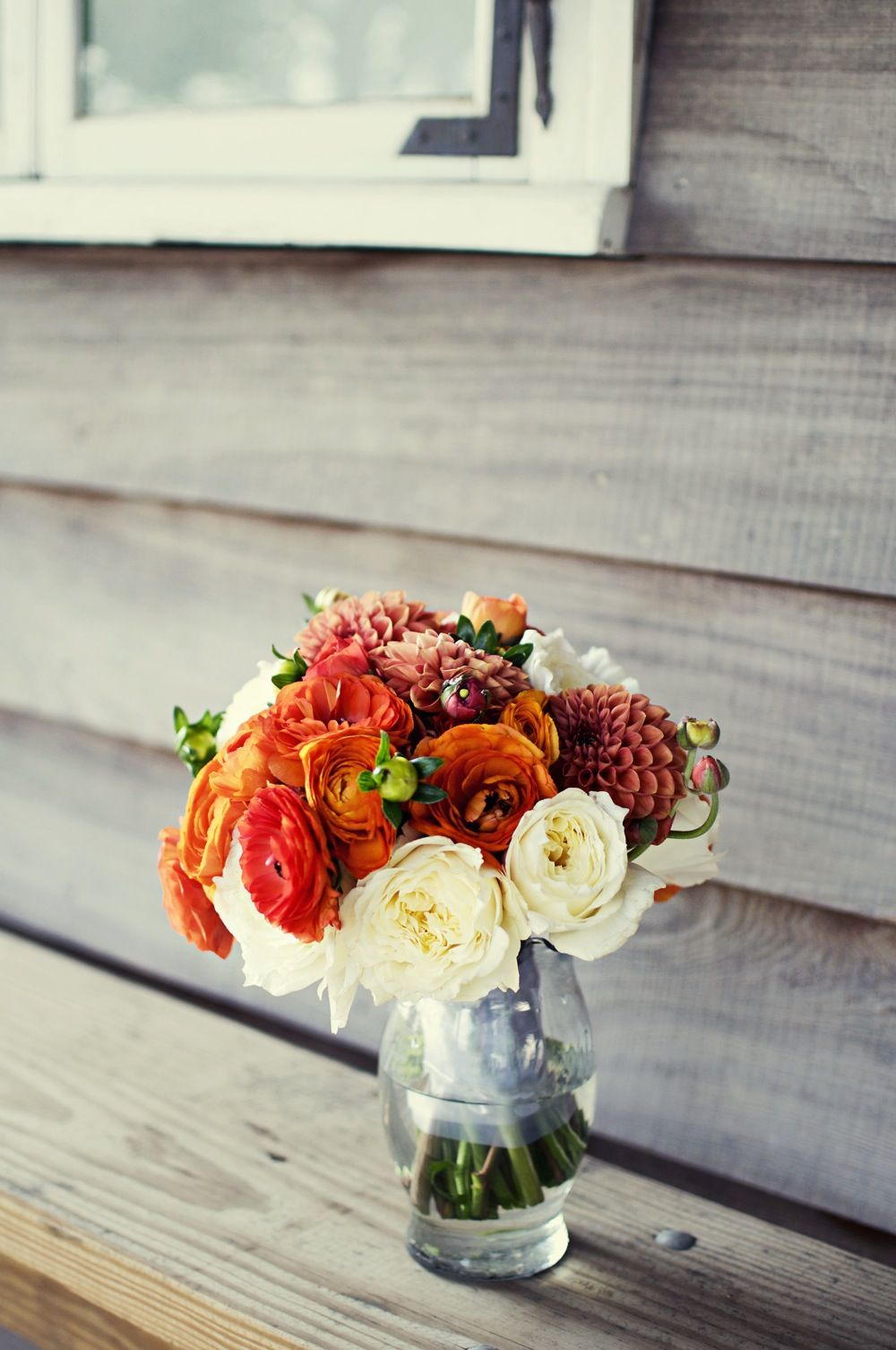 orange bouquet for table centerpiece - love  the colours and the type of flowers used