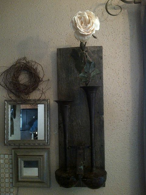 My unique wall art.....antique air horn from a semi truck mounted on barn wood and used as a vase for a simple cabbage rose.