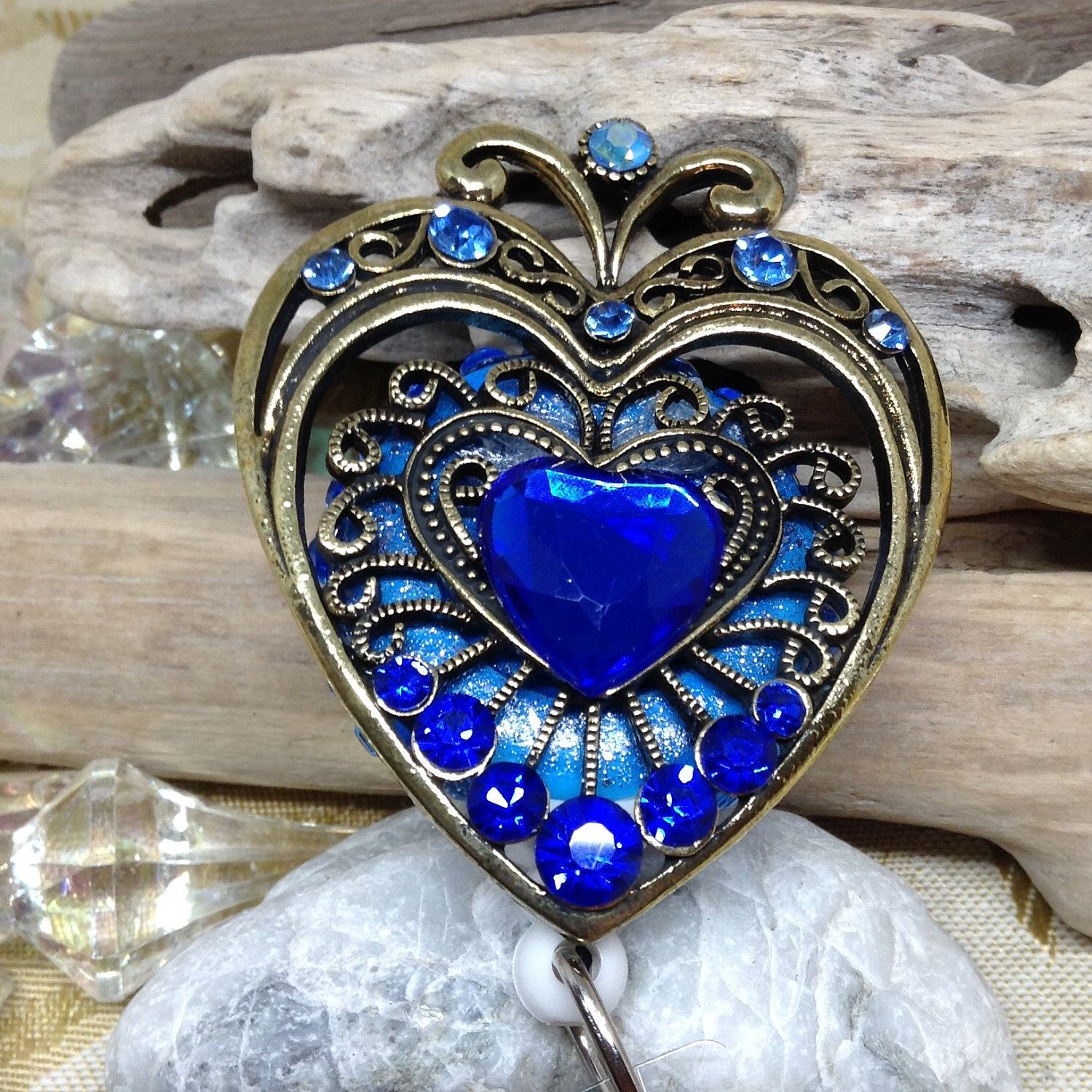 Gold Gemstone with Blue Beautiful Heart Badge Reel