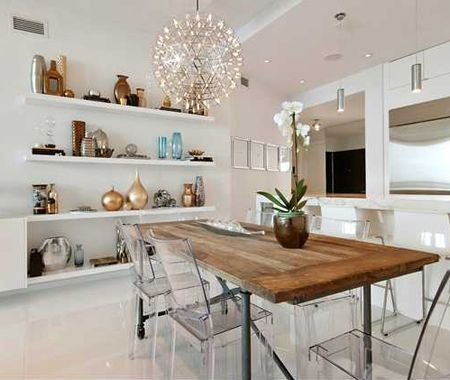 Modern open concept shelving // lucite chairs // wood distressed table // kitchen