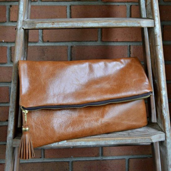 If I can sew this gorgeous leather clutch, anyone can! Even the tassel is DIY'd.