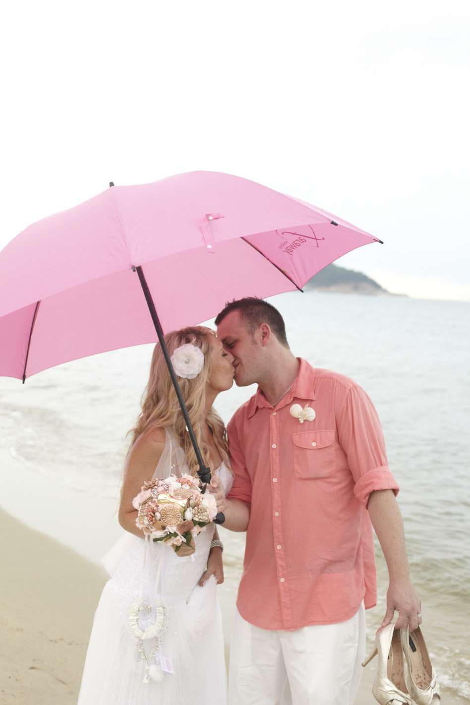 Don't forget the pink umberella....even a beach wedding can have a shower or two! Beach weddings, Koh Samui, Thailand