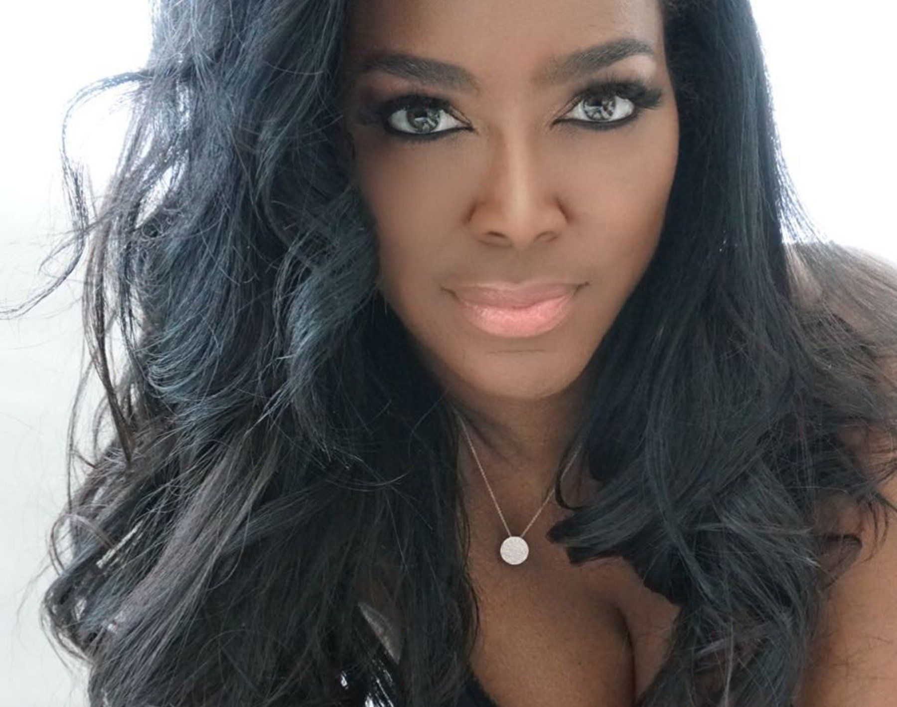 Kenya Moore Is Swept Away On A Secret Trip By Marc Daly