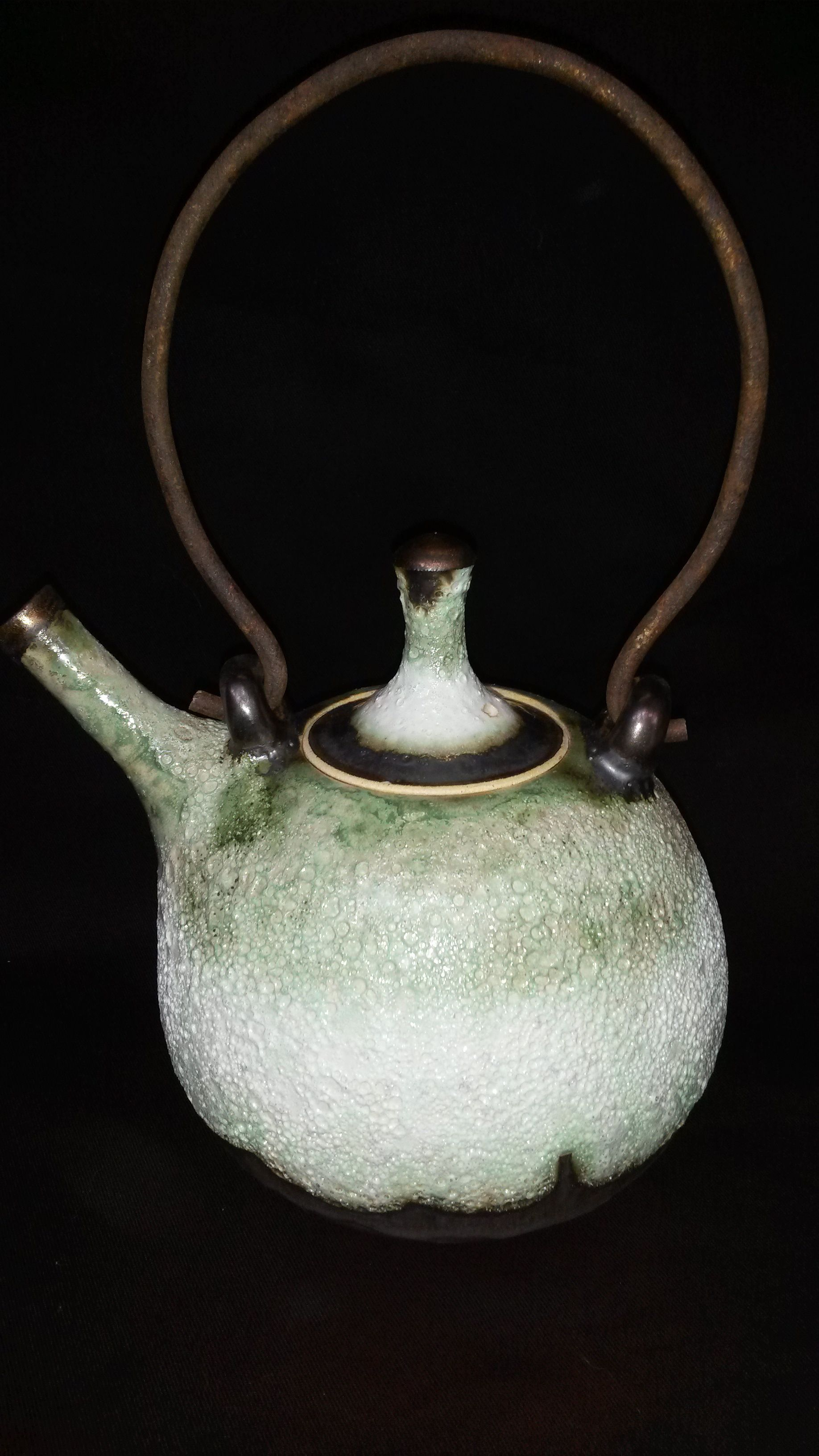 Teapot by Lissa Claassens. Volcanic glaze with copper