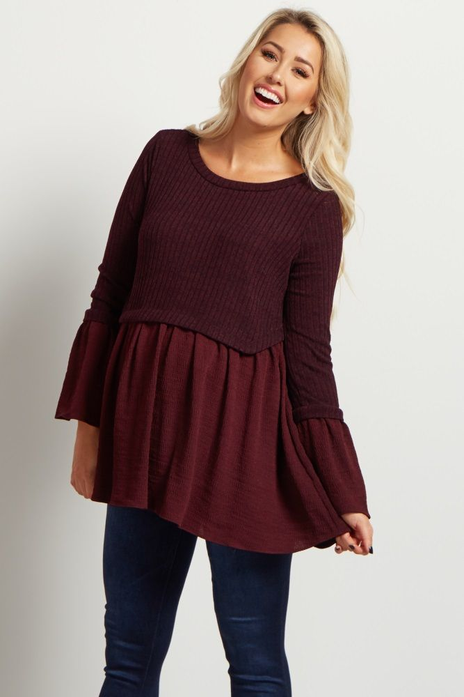 89e5e97f37a Keep your wardrobe looking new and chic with this cute peplum maternity top!  The cropped soft knit material and flowy peplum cut will show off your ...