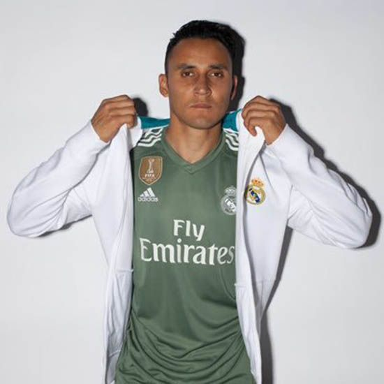 30f6d8c4c The Real Madrid 17-18 goalkeeper kit is  Trace Green  and white ...