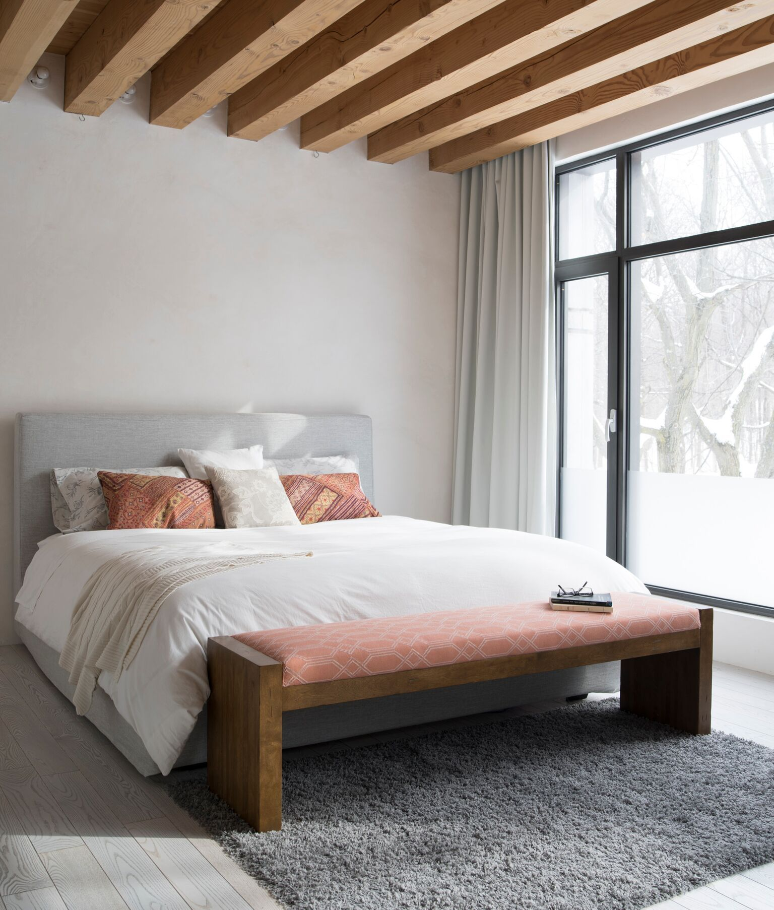 Create a chic bedroom by adding a bench at the foot of the