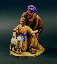 Pastor adorando con niño