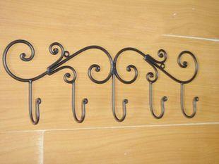European-style wrought iron garden furniture behind the door, walls, coat racks, coat hooks