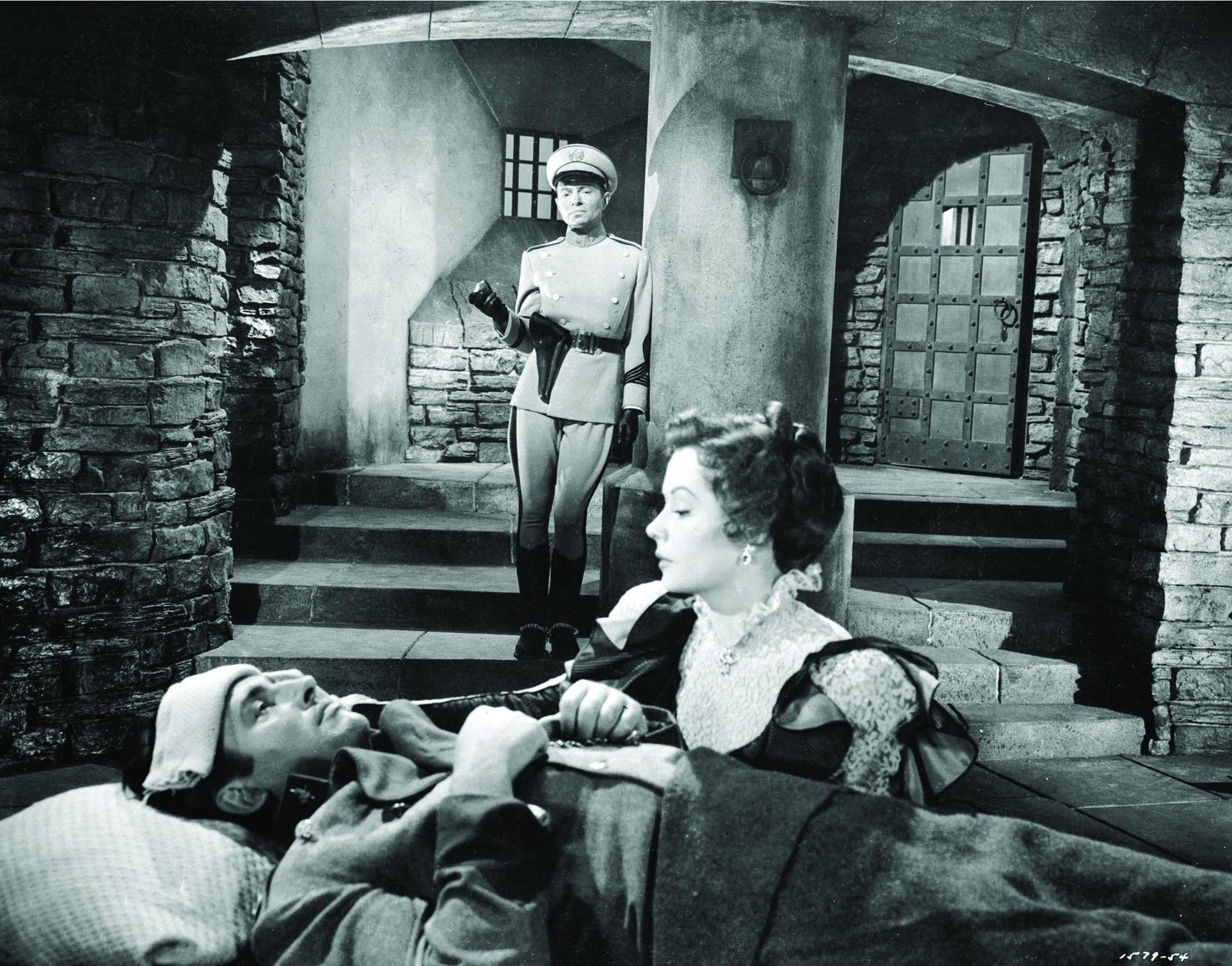 James Mason, Stewart Granger, and Jane Greer in The Prisoner of Zenda (1952) http://www.movpins.com/dHQwMDQ1MDUz/the-prisoner-of-zenda-(1952)/still-1633595392