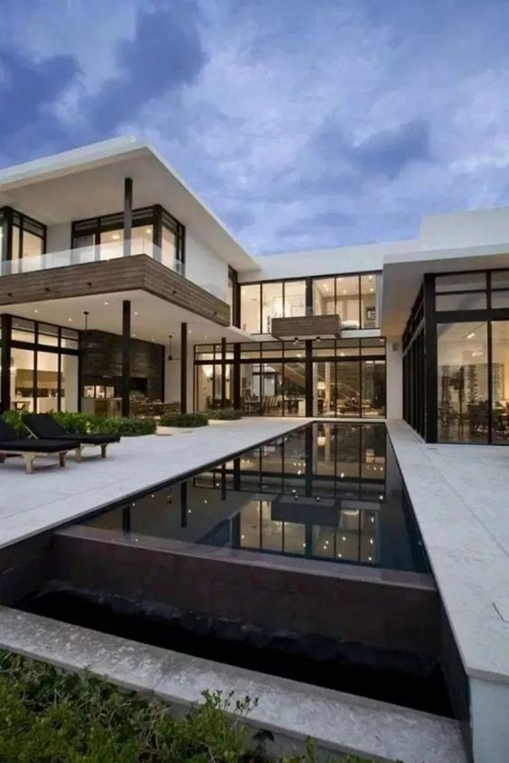 Find the most impressive and modern house exterior designs here. #exterior #exteriordesign #house #farmhouse #housedesign #farmhousedesign #backyarddesign #garden #gardendesign #luxuryhouse #luxuryexterior #architecture #bungalowdesign