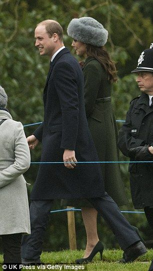 Kate wore the coat over a colourful printed dress...