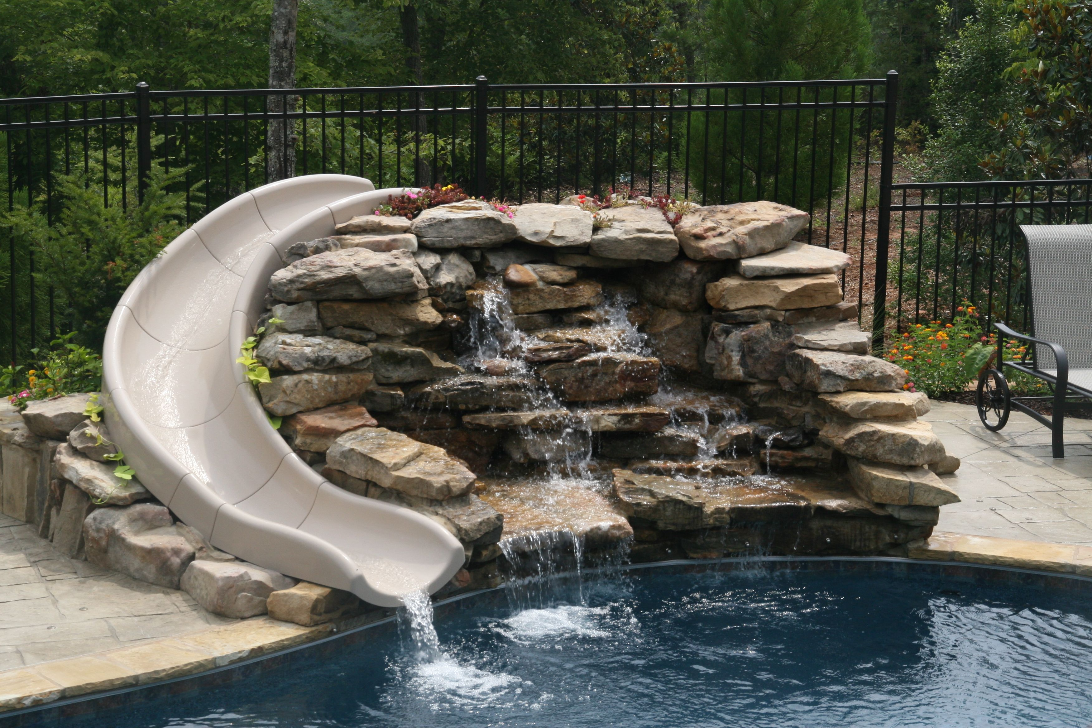 Natural slide with stacked stone waterfall | Building a ...
