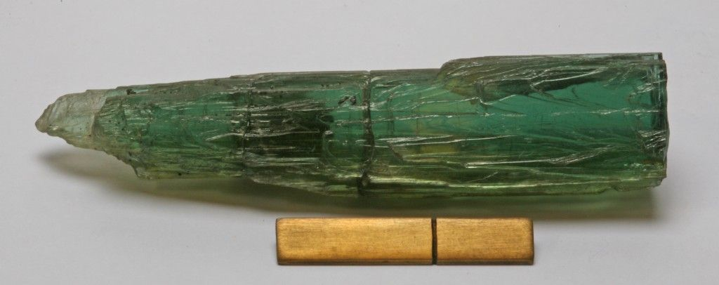 Zoisite, Ca2Al3(Si2O7)(SiO4)O(OH), Shigar Valley, Skardu District, Baltistan, Gilgit-Baltistan, Pakistan. Dimensions: 60x13x5 mm. An etched crystal of zoisite. The scale under the image is an inch with a rule at one cm.    Uploaded by: Rock Currier