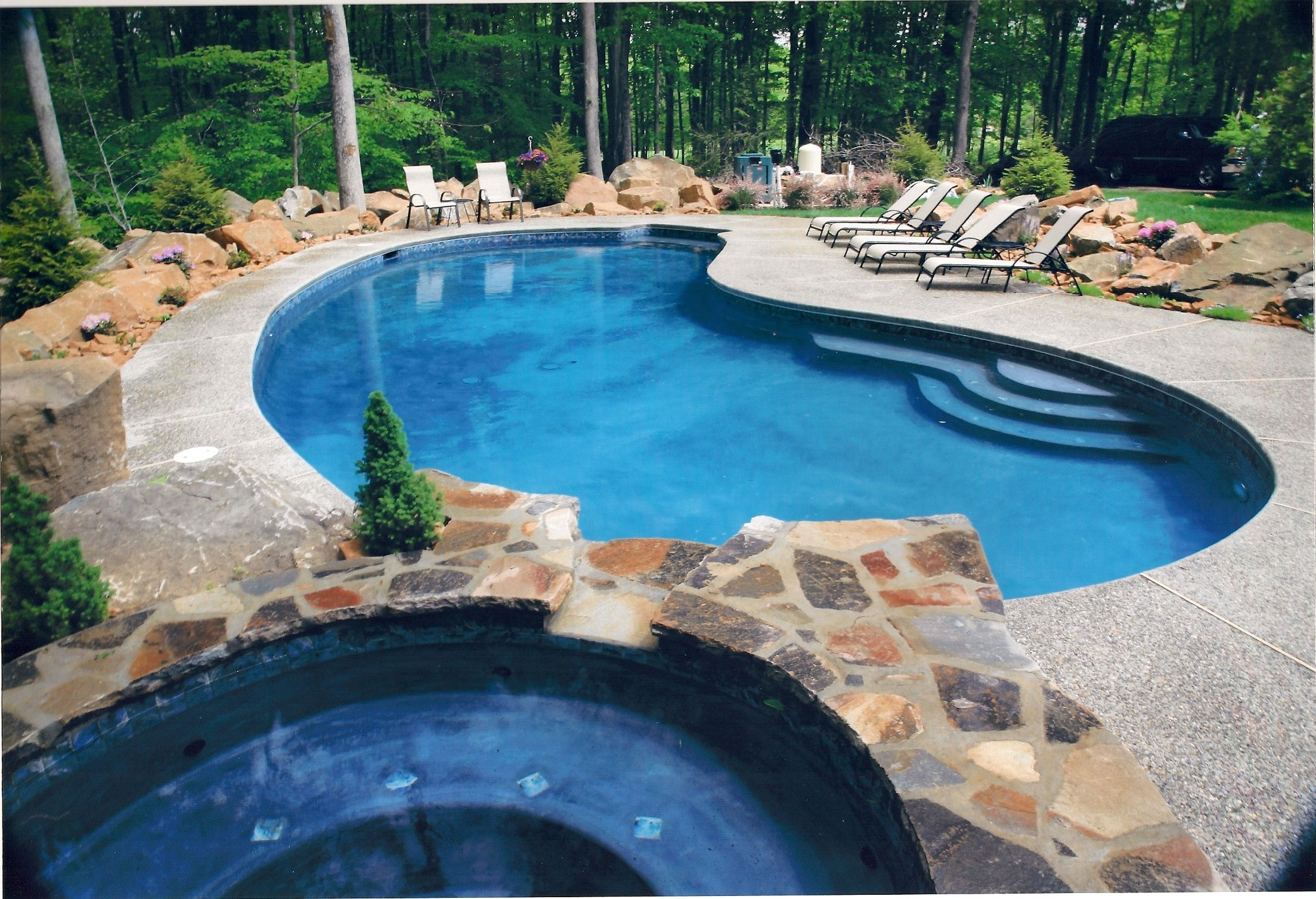Free form in ground gunite concrete plaster pool and spa for Concrete pool builders