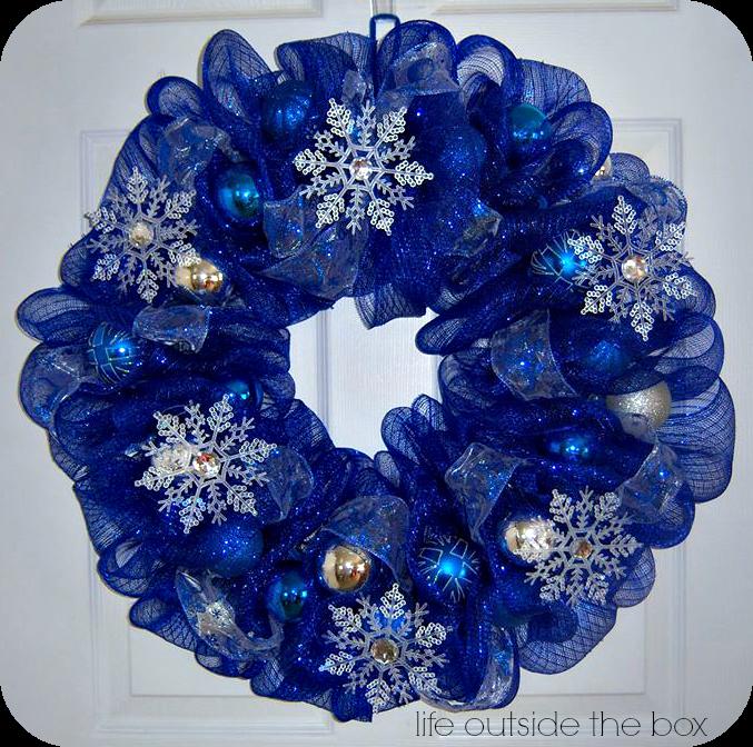 Blue mesh wreath w/ white snowflakes all around