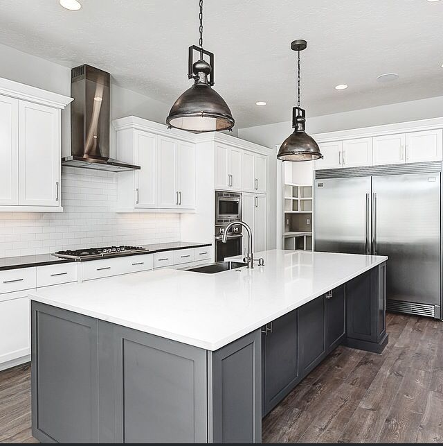 Peppercorn by Sherwin Williams paint on the island. Carrara Quartz counter on island.  Built by Clark and Co Homes Designed by Hailey Dawson