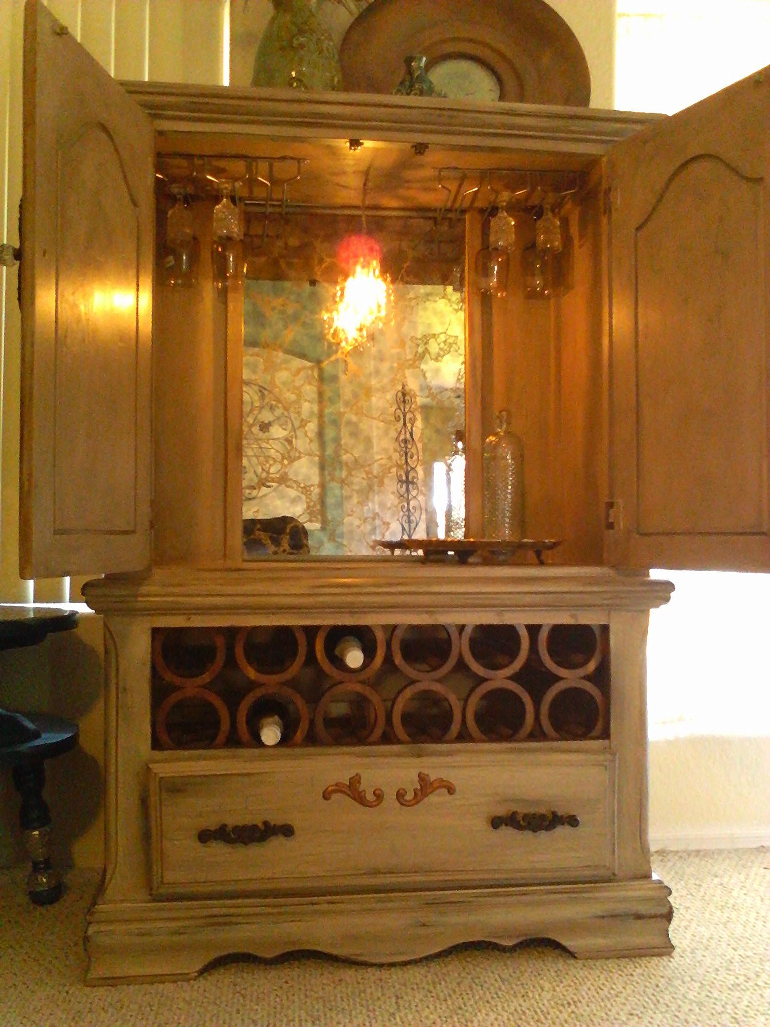 Repurposed armoire beautiful wine storage bar