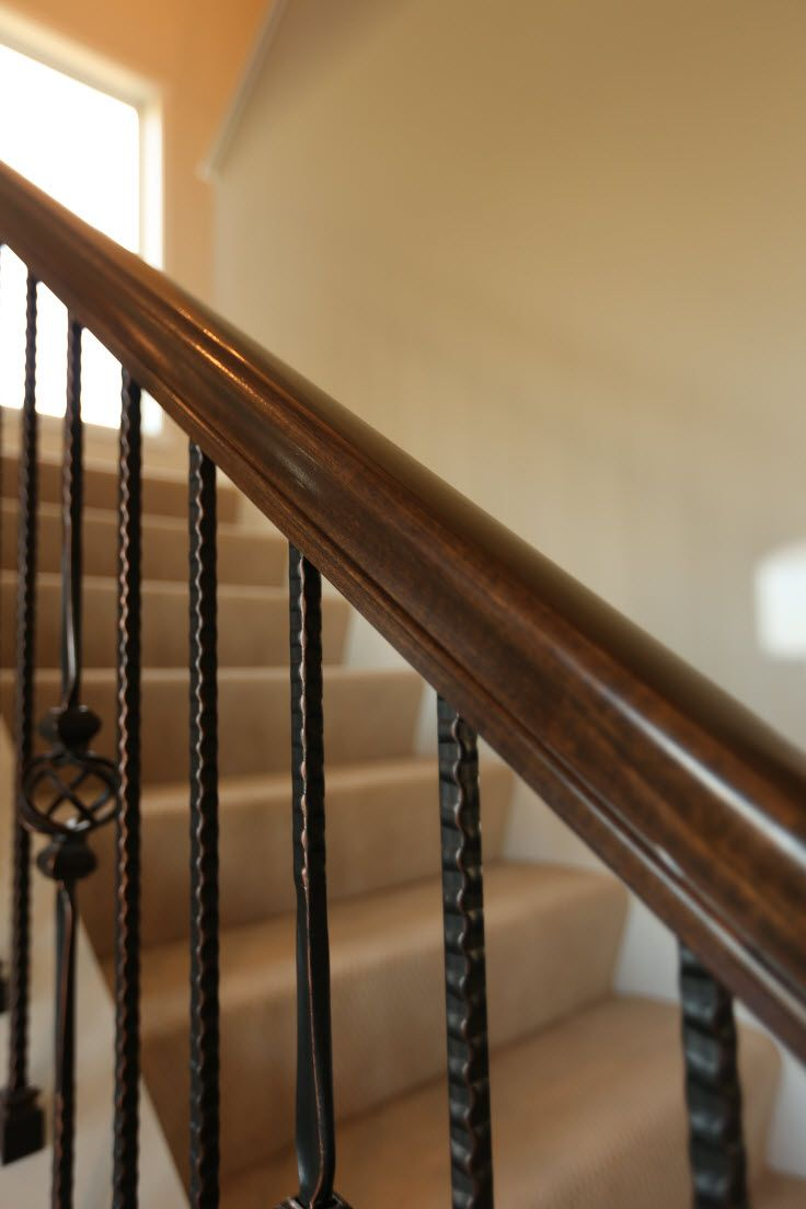 Stair Systems Dark Wood Hand Rail And Wrought Iron