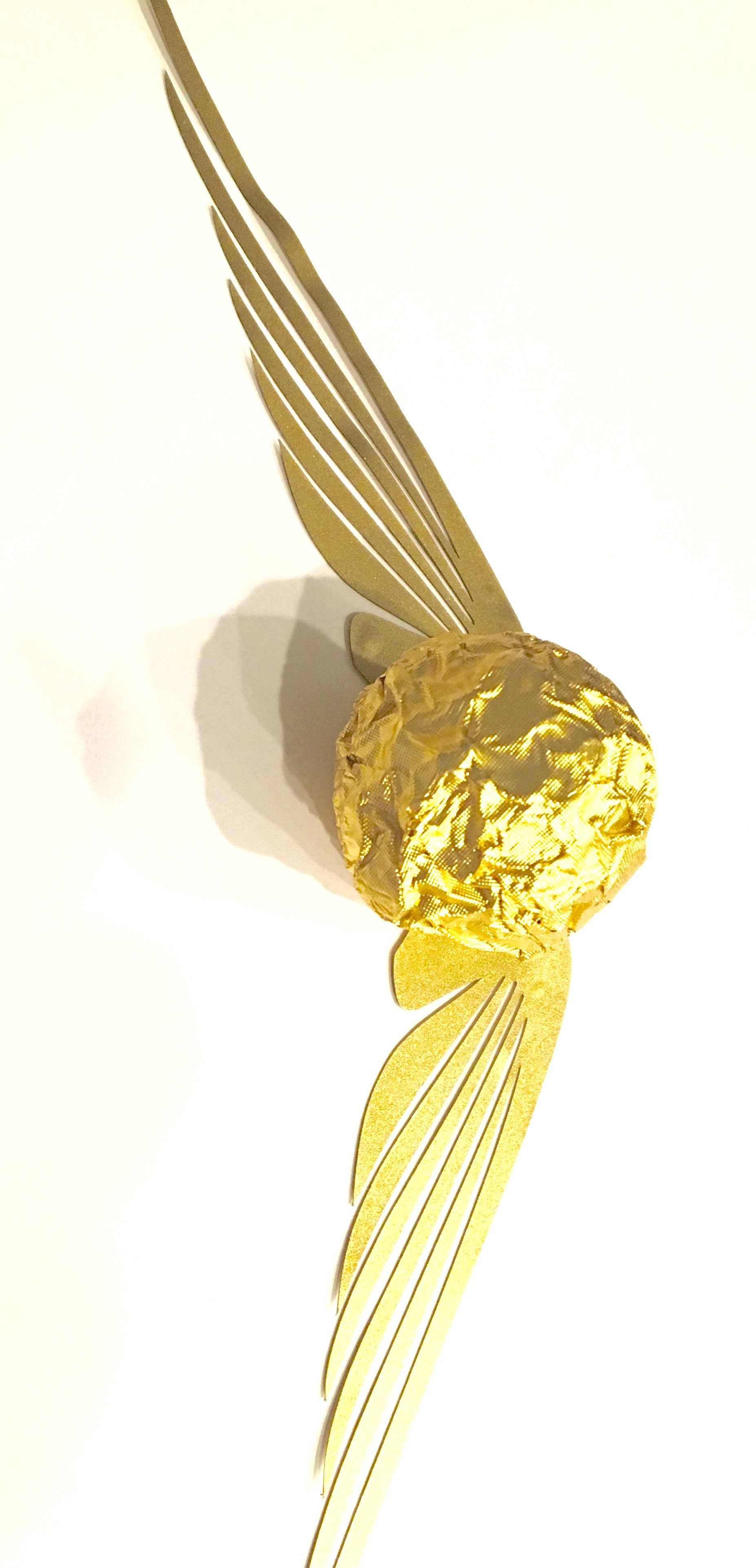 Golden Snitch party favor. Made from Ferrero Rocher chocolate balls ...