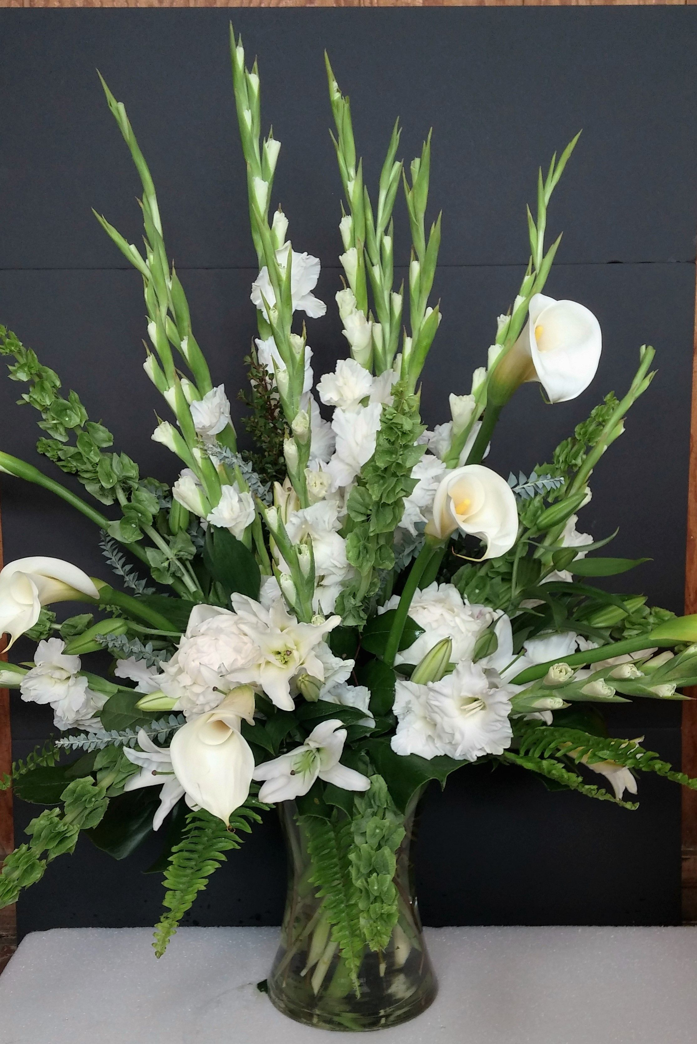 Elegant Sympathy Arrangement Calla Lilies Bells Of Ireland Lilies Gladiolus Flower Arrangements Calla Lily Wedding Centerpiece Gladiolus Centerpiece