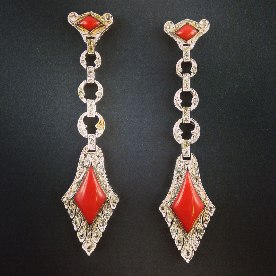 An Art Deco platinum, Diamond and coral earrings. Pennisi Milano
