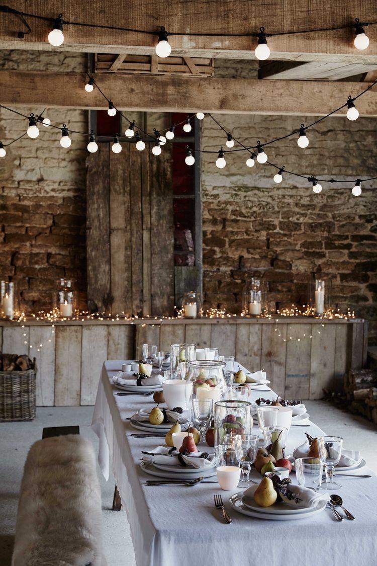 Barn wedding table settings  Rustic decor with lights  Barn Weddings  Pinterest  Rustic decor