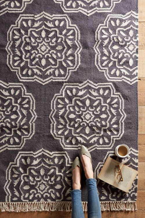 Patterned medallions are interspersed with thin, metallic strands on this durable flatwoven rug. Love it.