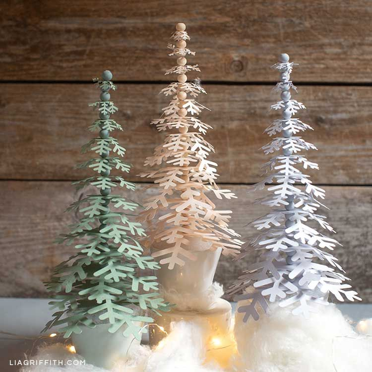 Paper Snowflake Trees For Your Holiday Decor Lia Griffith In 2020 Christmas Paper Crafts Holiday Crafts Christmas Paper Snowflakes Diy