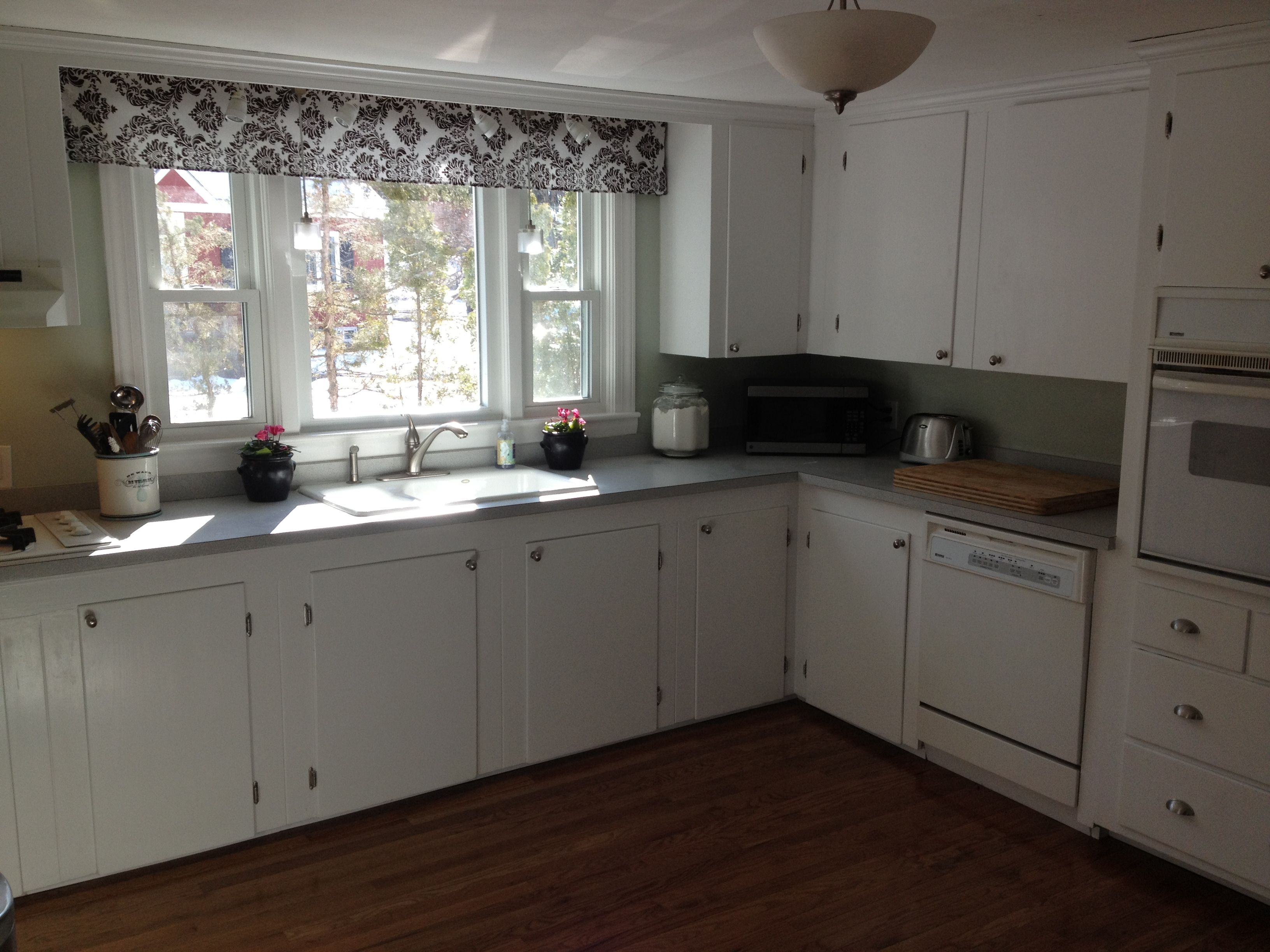 1950s Kitchen facelift: white cabinets with new hardware ...