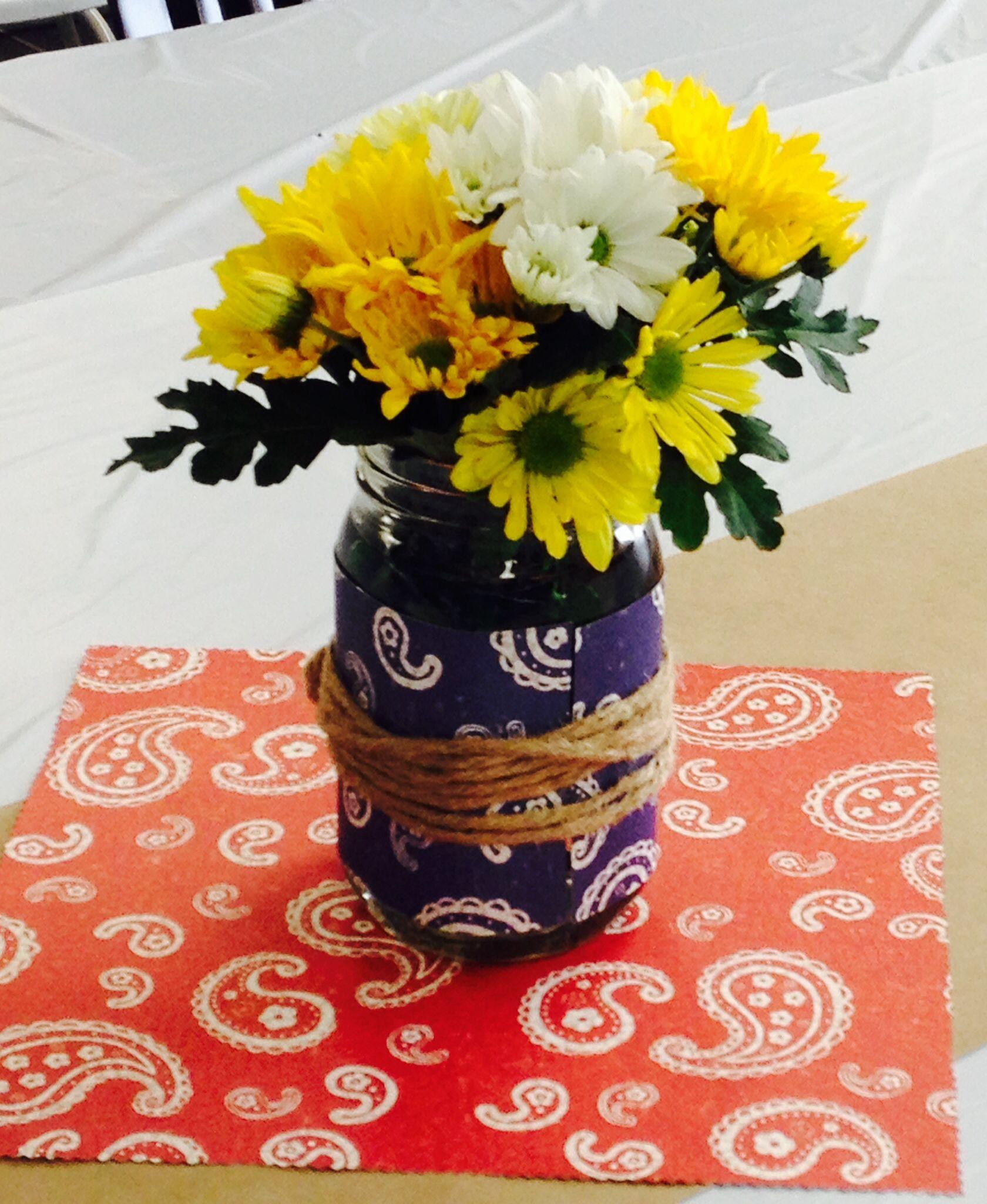 Baby-Q centerpieces using mason jars, bandana card stock, twine and daisies!