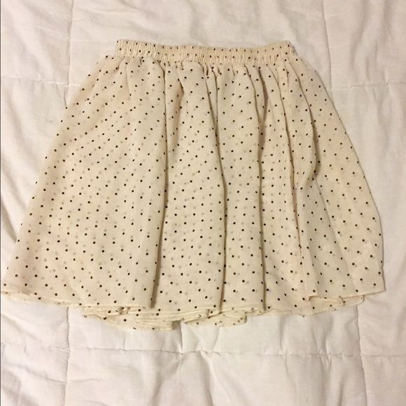 Chiffon Polka Dot American Apparel Skirt Worn once, cream colored skirt with black polka dots. Fits a size small, but has elastic so it might be able to fit a medium but there's no guarantee. No label but I promise it's American apparel  American Apparel Skirts Mini