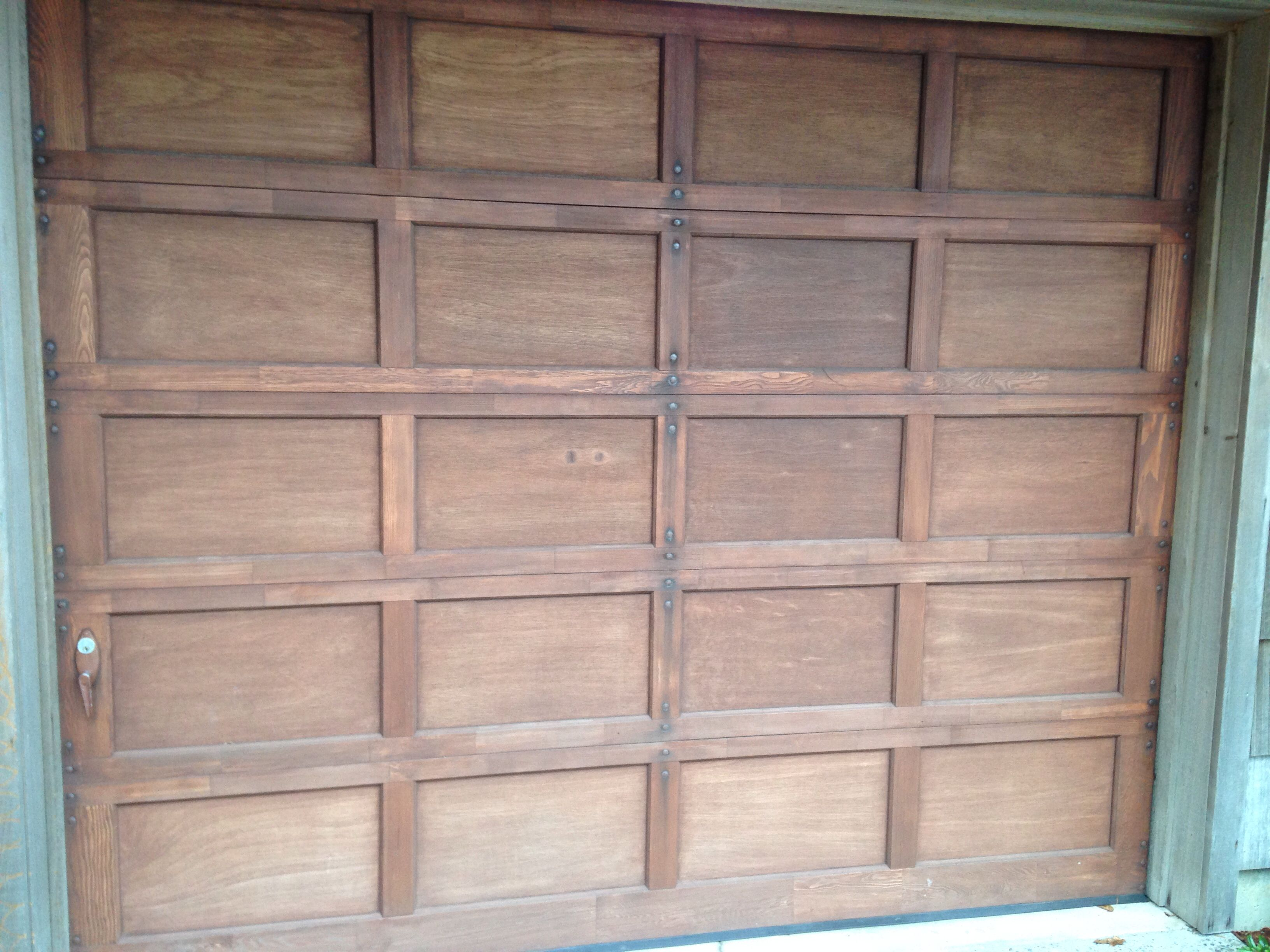 People Often Upgrade Their Old Wood Recessed Panel Garage