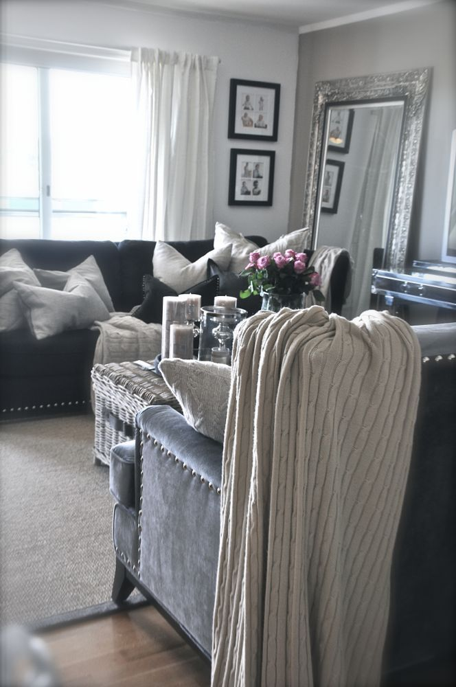 Such a cute living room! Long silver grey couches with little pops ...