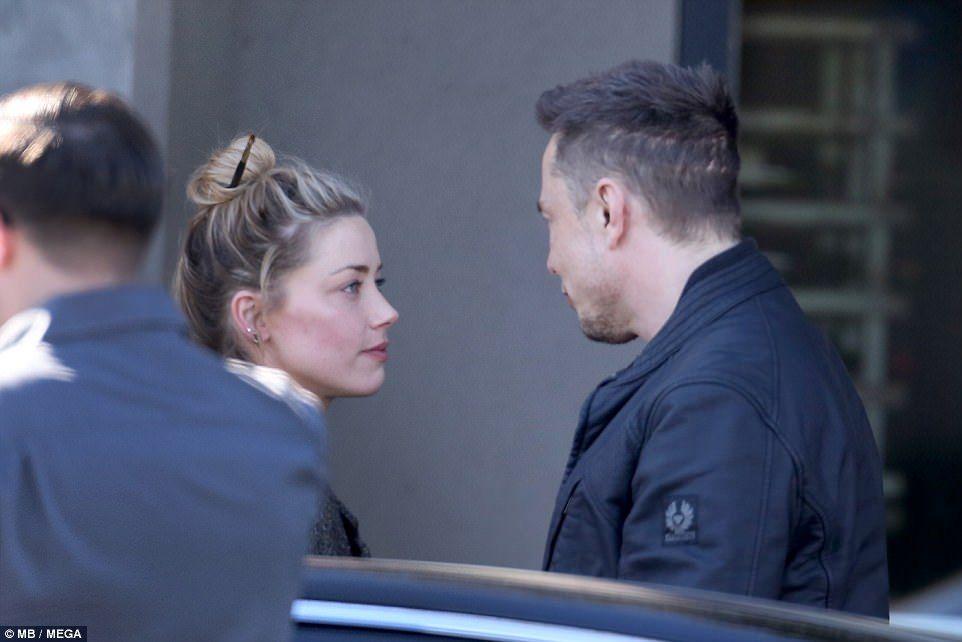 Amber Heard and billionaire Elon Musk share a steamy kiss