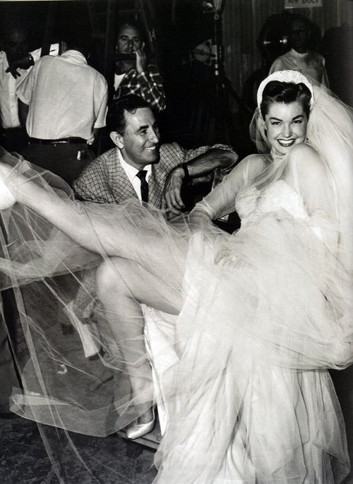 Esther Williams, actress and swimmer and swimming actress, poses in a wedding dress, 1952. Fun!