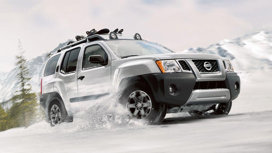 2015 Nissan Xterra In Glacier White Driving In The Snow Future