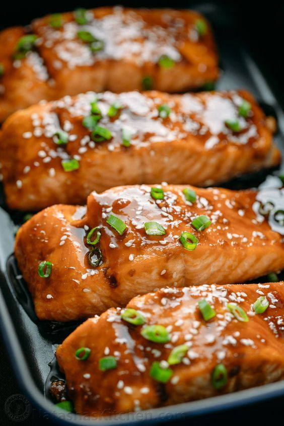 This teriyaki salmon recipe is a winner! Simple ingredients and no lengthy marinating needed. A flaky, juicy and delicious teriyaki glazed salmon recipe. #seafood #salmon #teriyakisalmon